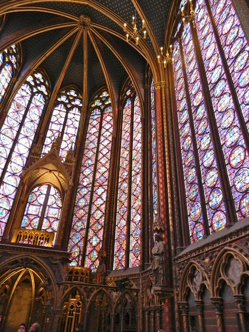 Sainte Chappel is known for its 50' stained glass windows and for being built with steel supports instead. of flying buttresses