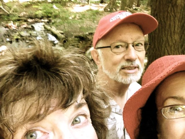 "August 9: Insist that my parents stop to take a selfie on a precarious bridge over mosquito-infested stream during a ""hike"" (walk) through Audobon Wilderness Sanctuary, Pittsfield, MA."