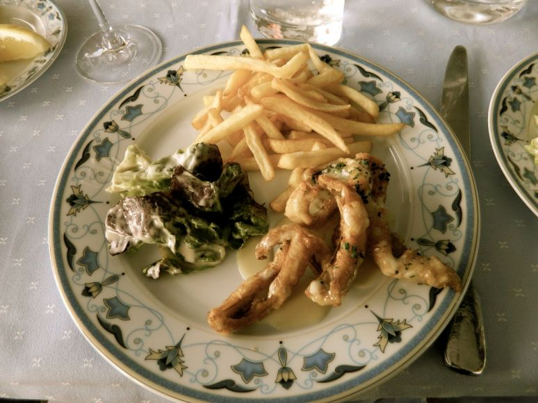 Petite perch from lake, fried with lemon butter sauce, salad and pom frites.